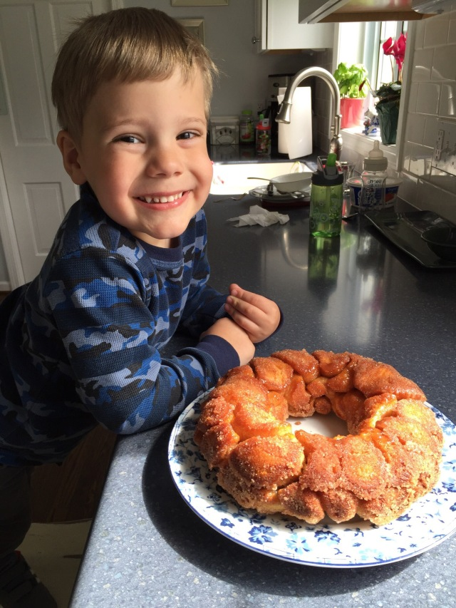Happy kid after making Monkey Bread with Grammy & Papa